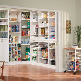 Photo of a traditional kitchen pantry in Other with louvered cabinets and white cabinets.