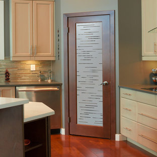 Kitchen pantry - mid-sized contemporary l-shaped kitchen pantry idea in Other with an island, raised-panel cabinets, medium tone wood cabinets, granite countertops, beige backsplash, ceramic backsplash and stainless steel appliances