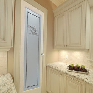 Inspiration for a mid-sized l-shaped kitchen pantry remodel in Other with raised-panel cabinets, medium tone wood cabinets, granite countertops, beige backsplash, ceramic backsplash, stainless steel appliances and an island