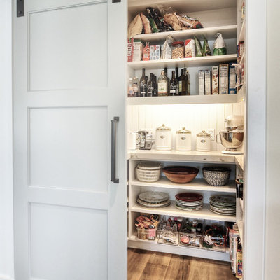 Inspiration for a large transitional medium tone wood floor kitchen pantry remodel in Orange County with an undermount sink, white cabinets, granite countertops, stainless steel appliances, subway tile backsplash and open cabinets
