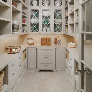 Design ideas for a traditional u-shaped kitchen pantry in Houston with glass-front cabinets, beige cabinets, beige splashback, beige floor, quartzite benchtops and porcelain floors.