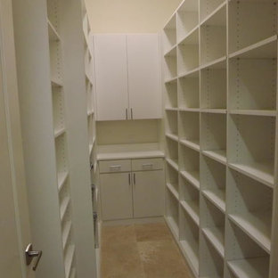Small traditional kitchen pantry appliance - Kitchen pantry - small traditional galley ceramic tile kitchen pantry idea in Tampa with open cabinets, white cabinets, laminate countertops, white backsplash and wood backsplash