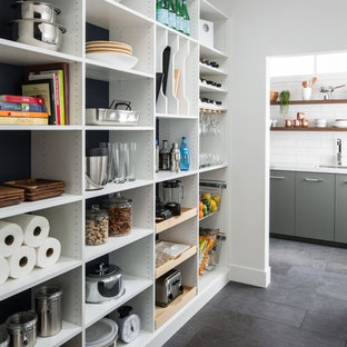 Mid-sized contemporary kitchen pantry pictures - Kitchen pantry - mid-sized contemporary u-shaped slate floor and gray floor kitchen pantry idea in Chicago with flat-panel cabinets, white cabinets, marble countertops, white backsplash, subway tile backsplash and no island