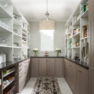 Example of a mid-sized country u-shaped gray floor and porcelain tile kitchen pantry design in Chicago with flat-panel cabinets, medium tone wood cabinets, solid surface countertops and no island
