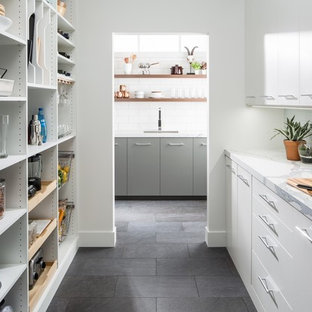 Inspiration for a mid-sized contemporary u-shaped gray floor and slate floor kitchen pantry remodel in Chicago with flat-panel cabinets, no island, white cabinets, marble countertops, white backsplash and subway tile backsplash