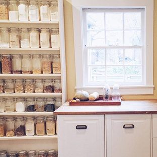This is an example of a small arts and crafts single-wall kitchen pantry in San Francisco with a double-bowl sink, open cabinets, white cabinets, wood benchtops, grey splashback, ceramic splashback, stainless steel appliances, dark hardwood floors, no island and brown floor.