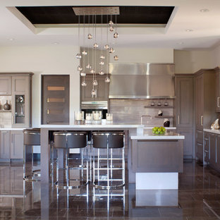 Inspiration for a large transitional u-shaped open plan kitchen in Denver with an undermount sink, recessed-panel cabinets, grey cabinets, quartzite benchtops, beige splashback, porcelain splashback, panelled appliances, marble floors and with island.