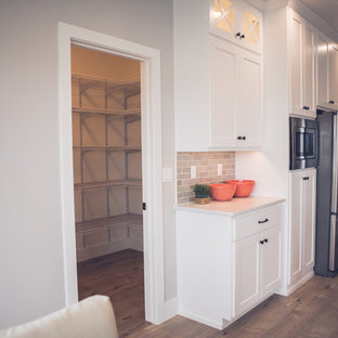 Photo of a mid-sized contemporary l-shaped kitchen pantry in Other with an undermount sink, shaker cabinets, white cabinets, marble benchtops, grey splashback, slate splashback, stainless steel appliances, light hardwood floors, with island and beige floor.