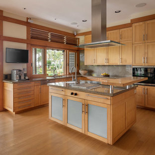 Large world-inspired l-shaped kitchen in Hawaii with a submerged sink, recessed-panel cabinets, granite worktops, brown splashback, stone slab splashback, integrated appliances, an island, brown worktops, medium wood cabinets, medium hardwood flooring and brown floors.