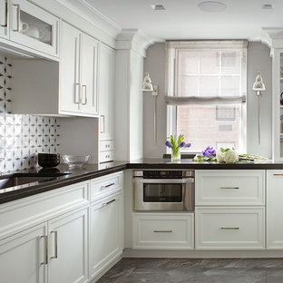 This is an example of a small traditional u-shaped kitchen in New York with an undermount sink, recessed-panel cabinets, white cabinets, onyx benchtops, white splashback, mosaic tile splashback, stainless steel appliances, ceramic floors and no island.