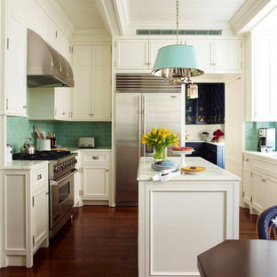 Small traditional eat-in kitchen remodeling - Inspiration for a small timeless u-shaped medium tone wood floor eat-in kitchen remodel in New York with flat-panel cabinets, white cabinets, marble countertops, green backsplash, ceramic backsplash, stainless steel appliances and an island