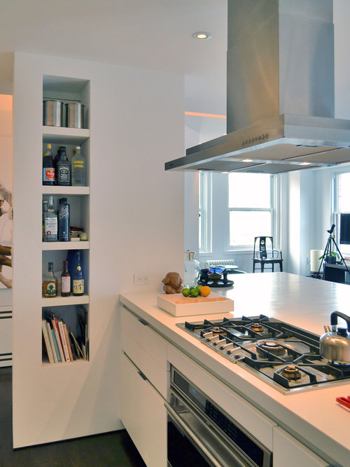 Trendy Kitchen Photo In New York With Open Cabinets, White Cabinets And  Stainless Steel Appliances