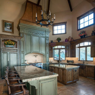 Inspiration for an expansive country galley open plan kitchen in Salt Lake City with a farmhouse sink, recessed-panel cabinets, green cabinets, granite benchtops, white splashback, mosaic tile splashback, panelled appliances, ceramic floors and multiple islands.