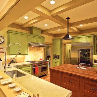 Large arts and crafts u-shaped eat-in kitchen in Salt Lake City with an undermount sink, recessed-panel cabinets, green cabinets, marble benchtops, brown splashback, stone tile splashback, stainless steel appliances, dark hardwood floors and with island.