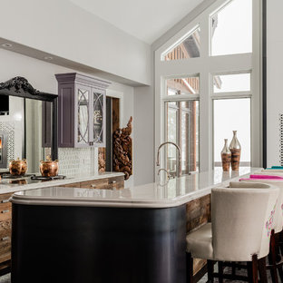 Eclectic open concept kitchen remodeling - Open concept kitchen - eclectic galley open concept kitchen idea in Salt Lake City with flat-panel cabinets, medium tone wood cabinets, white backsplash and an island