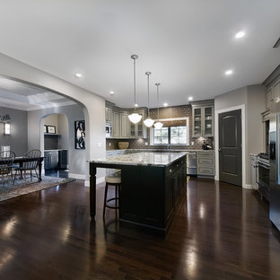 Elegant kitchen photo in Denver with stainless steel appliances and gray cabinets