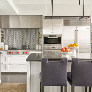 Transitional eat-in kitchen designs - Eat-in kitchen - transitional u-shaped dark wood floor and brown floor eat-in kitchen idea in Chicago with soapstone countertops, mosaic tile backsplash, stainless steel appliances, an undermount sink, shaker cabinets, white cabinets, gray backsplash and an island