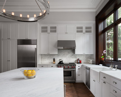 In kitchen photo in new york with a farmhouse sink shaker cabinets