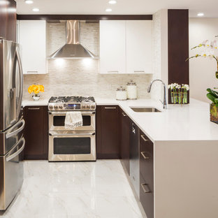 This is an example of a mid-sized transitional u-shaped eat-in kitchen in New York with flat-panel cabinets, quartz benchtops, white splashback, mosaic tile splashback, stainless steel appliances, an undermount sink, white cabinets, marble floors and a peninsula.