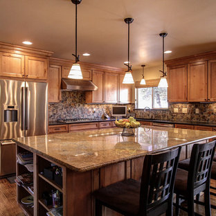 Traditional kitchen in Denver with stainless steel appliances and slate splashback.