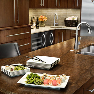 Modern eat-in kitchen pictures - Eat-in kitchen - modern u-shaped light wood floor and brown floor eat-in kitchen idea in Other with an undermount sink, flat-panel cabinets, medium tone wood cabinets, granite countertops, multicolored backsplash, glass tile backsplash, stainless steel appliances and an island