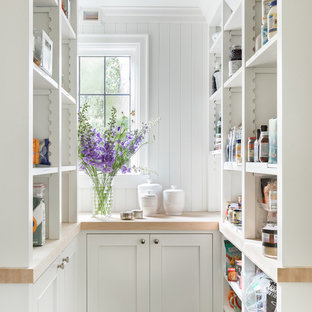 This is an example of a traditional u-shaped kitchen pantry in Seattle with open cabinets, white cabinets, wood benchtops and white splashback.