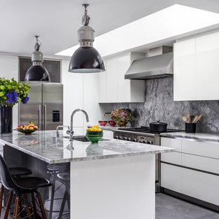 Design ideas for a large contemporary l-shaped kitchen in London with a submerged sink, flat-panel cabinets, white cabinets, grey splashback, stainless steel appliances, an island, grey floors, grey worktops and marble worktops.