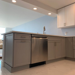 Small modern open concept kitchen inspiration - Small minimalist l-shaped marble floor and white floor open concept kitchen photo in Miami with an undermount sink, shaker cabinets, gray cabinets, marble countertops, stainless steel appliances, a peninsula and white countertops