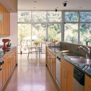 Mid-sized midcentury modern open concept kitchen inspiration - Mid-sized 1960s galley light wood floor open concept kitchen photo in Los Angeles with a double-bowl sink, recessed-panel cabinets, medium tone wood cabinets, granite countertops, red backsplash, porcelain backsplash, stainless steel appliances and no island
