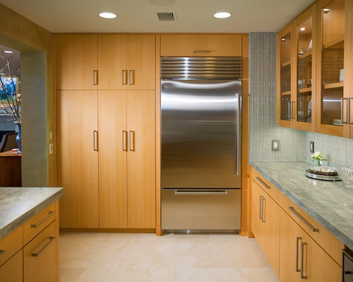Trendy kitchen photo in Other with glass-front cabinets and stainless ...