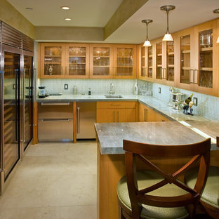 Design ideas for a contemporary kitchen in Los Angeles with glass-front cabinets and stainless steel appliances.
