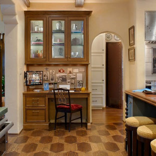 Photo of a mediterranean kitchen in Los Angeles with wood benchtops and green benchtop.