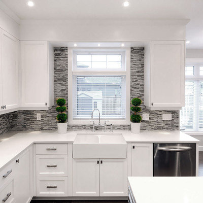 Transitional eat-in kitchen photo in Other with glass-front cabinets, a farmhouse sink, multicolored backsplash, matchstick tile backsplash and stainless steel appliances