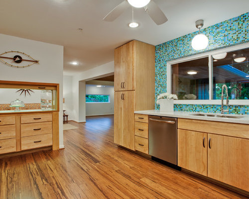 Inspiration for a large 1960s u-shaped bamboo floor and brown floor kitchen  remodel in