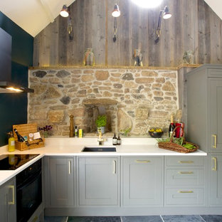 This is an example of an eclectic kitchen in Devon.