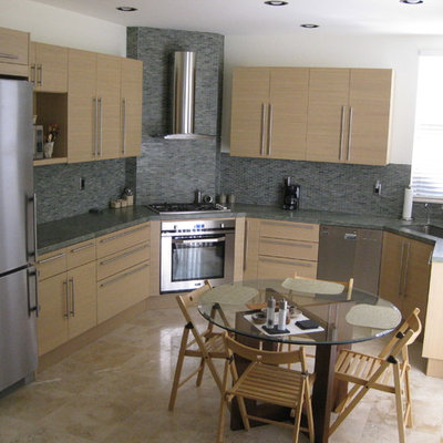 Inspiration for a mid-sized contemporary l-shaped ceramic tile eat-in kitchen remodel in San Diego with a single-bowl sink, flat-panel cabinets, light wood cabinets, granite countertops, multicolored backsplash, mosaic tile backsplash, paneled appliances and no island