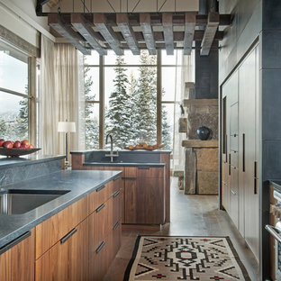 Rustic open concept kitchen designs - Inspiration for a rustic galley dark wood floor and brown floor open concept kitchen remodel in Other with an undermount sink, flat-panel cabinets, medium tone wood cabinets and an island