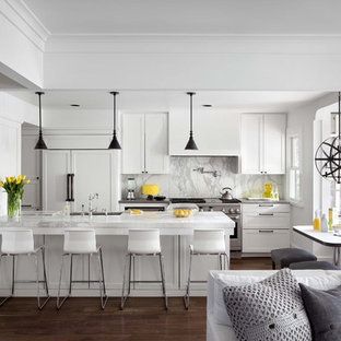 Inspiration for a traditional galley open plan kitchen in Austin with panelled appliances, white cabinets, marble benchtops, white splashback, stone slab splashback and recessed-panel cabinets.