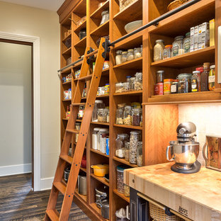 Farmhouse kitchen pantry remodeling - Inspiration for a farmhouse dark wood floor kitchen pantry remodel in Other with wood countertops, open cabinets and medium tone wood cabinets