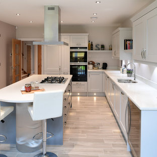 Medium Sized Traditional L Shaped Enclosed Kitchen In London With Porcelain Flooring Beige Floors