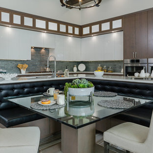 Inspiration for a contemporary l-shaped eat-in kitchen in Tampa with an undermount sink, flat-panel cabinets, medium wood cabinets, quartz benchtops, blue splashback, glass tile splashback, stainless steel appliances, with island, multi-coloured floor and white benchtop.