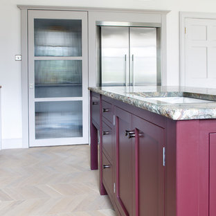 Inspiration for a mid-sized traditional open plan kitchen in Other with a double-bowl sink, shaker cabinets, purple cabinets, granite benchtops, metallic splashback, glass tile splashback, stainless steel appliances, light hardwood floors, with island, grey floor and green benchtop.