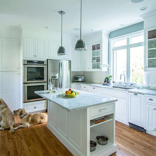 Inspiration for a mid-sized traditional u-shaped separate kitchen in Philadelphia with an undermount sink, beaded inset cabinets, white cabinets, quartzite benchtops, white splashback, ceramic splashback, stainless steel appliances, medium hardwood floors, with island, beige floor and green benchtop.