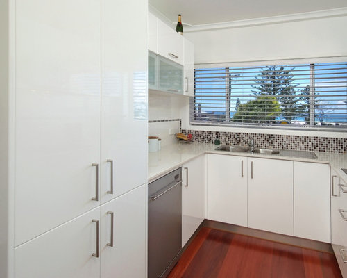 Contemporary brushed aluminium kickboards kitchen design for Brushed aluminum kitchen cabinets