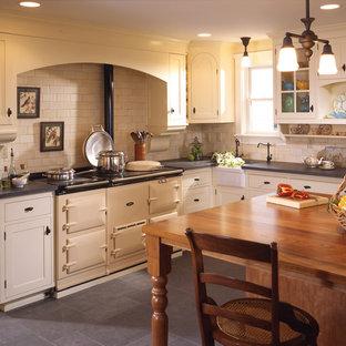 Kitchen - traditional kitchen idea in Seattle with subway tile backsplash, a farmhouse sink, wood countertops, beige backsplash and white appliances