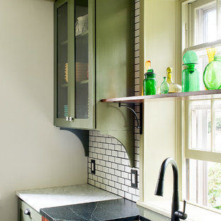 Mid-sized victorian enclosed kitchen ideas - Example of a mid-sized ornate u-shaped ceramic tile and gray floor enclosed kitchen design in Philadelphia with an undermount sink, recessed-panel cabinets, medium tone wood cabinets, white backsplash, stainless steel appliances, an island, soapstone countertops and subway tile backsplash