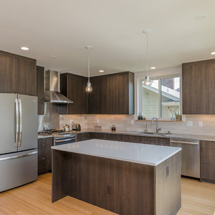Inspiration for a mid-sized modern l-shaped open plan kitchen in Seattle with an integrated sink, flat-panel cabinets, dark wood cabinets, quartz benchtops, beige splashback, porcelain splashback, stainless steel appliances, bamboo floors and with island.