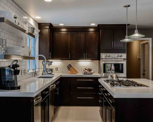 inspiration for a contemporary kitchen remodel in philadelphia with stainless steel appliances and beige floors - Merillat Classic Kitchen Cabinets