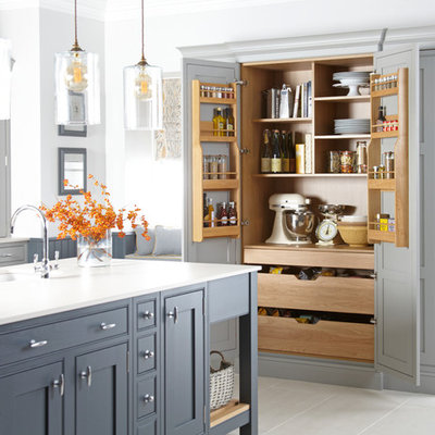 Example of a country kitchen design in Other with a single-bowl sink, shaker cabinets, gray cabinets and an island