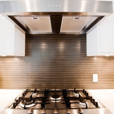 Example of a trendy kitchen design in Calgary with flat-panel cabinets, white cabinets and brown backsplash